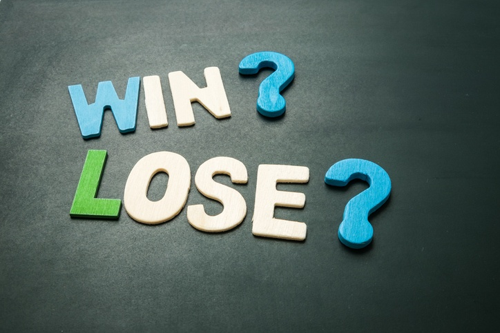 "Photo with text spelling out ""Win?"" and ""Lose?"""